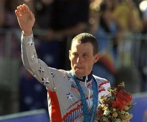 This Sept. 30, 2000 file photo shows Lance Armstrong waving after receiving the bronze medal in the men's individual time trials at the 2000 Summer Olympics cycling road course in Sydney, Australia.