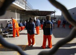 In this photo taken Jan. 12, 2012  inmates are seen in a recreation yard at the Deuel Vocational Institution in Tracy, Calif.