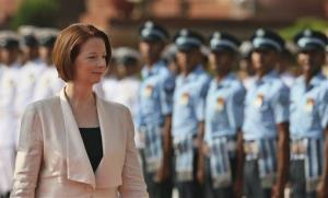 Australian Prime Minister Julia Gillard inspects a guard of honor on her arrival at the Indian presidential palace for a ceremonial reception in New Delhi, India, Wednesday.