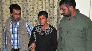 Najibullah (center) has confessed to the murder of Mah Gul in Herat Province.