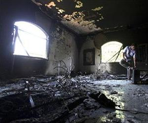 In this Sept. 13 file photo, a Libyan man investigates the inside of the US consulate in Benghazi, after an attack that killed four Americans, including Ambassador Chris Stevens.