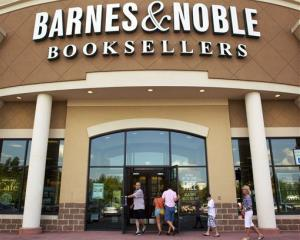 In this Monday, June 18, 2012, file photo customers enter the Barnes and Noble Booksellers store in Hoover, Ala.