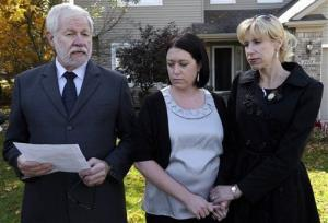 In this Oct. 9 photo, George Cary speaks at his home in Howell, Mich., with his daughters Heather Andrus, 33, center, and Jill Bloser, 43.