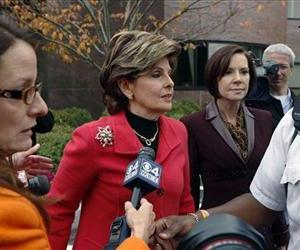 Maureen Stemberg Sullivan, second right, ex-wife of Staples founder Tom Stemberg, and her lawyer Gloria Allred, second left, leave Norfolk County Probate Court, Oct. 24, 2012, in Canton, Mass.