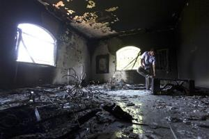 A Libyan man investigates the inside of the  U.S. Consulate, after an attack that killed four Americans, including Ambassador Chris Stevens on the night of Tuesday, Sept. 11, 2012.