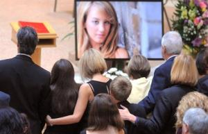 Family members of Alexandra Kogut attend her funeral at St. John the Evangelist Church, Thursday, Oct. 4, 2012, in New Hartford, NY.