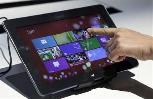 A person tries a Samsung tablet computer running Windows 8 at the launch.