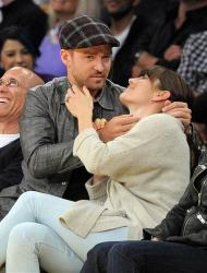 Justin Timberlake looks up after kissing Jessica Biel as they watch the Los Angeles Lakers play the Denver Nuggets, May 12, 2012, in Los Angeles.