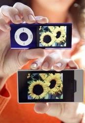The Apple iPod Nano, top, and the Microsoft Zune HD are shown in San Francisco, Wednesday, Sept. 16, 2009.