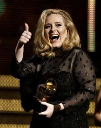 In this Feb. 12, 2012 file photo, Adele accepts the award for record of the year for Rolling in the Deep during the 54th annual Grammy Awards in Los Angeles.
