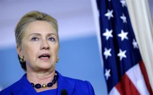 Hillary Clinton answers a reporter's question during a news conference on Wednesday, Oct. 24, 2012,  at the State Department in Washington.