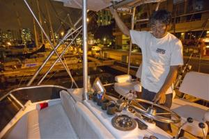 Mike Nakamoto of Honolulu prepares his client's boat moored at the Ala Wai Harbor to take it to deep water after learning of a tsunami warning Saturday, Oct. 27, 2012, in Honolulu.