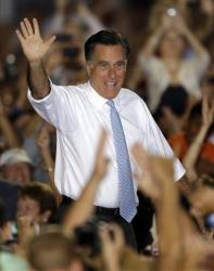 Mitt Romney waves to supporters before a campaign speech, Saturday, Oct. 27, 2012, in Land O' Lakes, Fla.