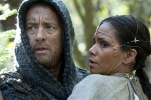 This film image released by Warner Bros. Pictures shows Tom Hanks as Zachry and Halle Berry as Meronym in a scene from Cloud Atlas, an epic spanning centuries and genres.