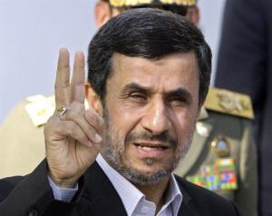 In this Sept. 1, 2012  file photo, Iranian President Mahmoud Ahmadinejad flashes a victory sign in Tehran, Iran.