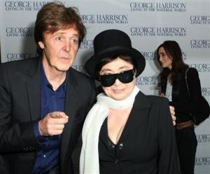 Paul McCartney talks to Yoko Ono as they arrive for the UK Premiere of George Harrison: Living in the Material World, at a central London cinema, Sunday, Oct. 2, 2011.