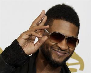 This is Sunday, Feb. 13, 2011, file photo of US R&B star  Usher posing backstage at the 53rd annual Grammy Awards  in Los Angeles.