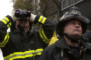 Two firemen observe the collapsed crane in Midtown Manhattan.