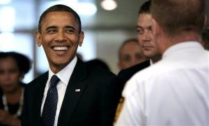 President Obama smiles as he leaves after addressing the 67th United Nations General Assembly at UN headquarters, Tuesday, Sept. 25, 2012.