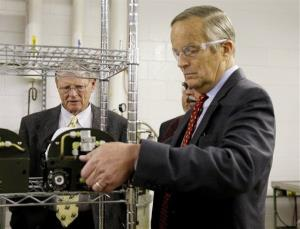 Rep. Todd Akin, R-Mo., picks up a portable medical oxygen pack as he tours Essex Industries, a supplier to the aerospace and defense industries, Monday, Oct. 29, 2012, in St. Louis County, Mo.