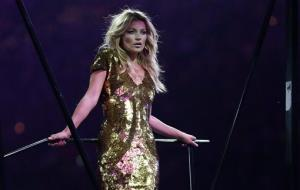 Kate Moss poses on stage during the Closing Ceremony at the 2012 Summer Olympics, Sunday, Aug. 12, 2012, in London.