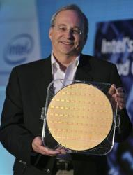 Intel Corporation Chief Technology Officer Justin Rattner shows a chip wafer of the 48-core Intel processor chip in this 2009 file photo.