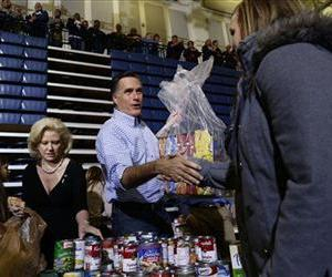 Mitt Romney accepts donations of food at a campaign event collecting supplies for victims of superstorm Sandy, Oct. 30, 0212, at the James S. Trent Arena in Kettering, Ohio.