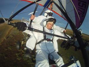 In this Wednesday Sept. 5, 2012,  file photo Russian President Vladimir Putin, foreground, flies in a motorized hang glider alongside a Siberian white crane.