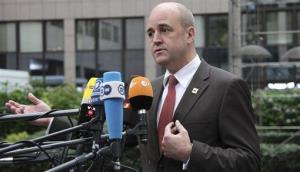 Sweden Prime Minister Fredrik Reinfeldt speaks with the media as he arrives for an EU summit in Brussels on Thursday, Oct. 18, 2012.