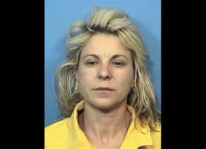 This Thursday, Nov. 1, 2012 booking photo provided by the DuPage County Sheriff's Department in Wheaton, Ill., shows Elzbieta Plackowska, 40, of Naperville, Ill.