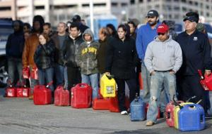 People line up at a gas station waiting to fill up Friday in Newark, N.J. The new rules don't apply to people on foot.