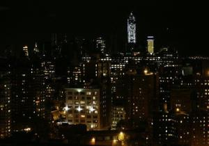 In this photo looking south from 33rd Street in New York City, lights are on  in some buildings in Lower Manhattan Friday.