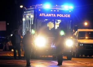 Law enforcement investigate the scene of an Atlanta Police Department helicopter crash early Sunday, Nov. 4, 2012, that killed two officers aboard when it crashed near a shopping center.