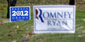 Campaign signs for both President Barack Obama and Mitt Romney are seen in yards outside Evans City, Pa., Friday, Nov. 2, 2012.