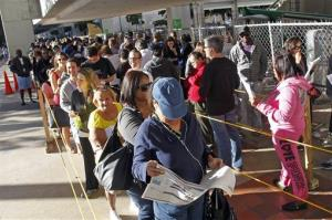 South Floridians stand in line during the last day of early voting in Miami, Saturday, Nov. 3, 2012.