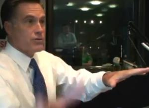 Romney gesticulates during his 2007 interview with Jan Mickelson of WHO-AM in Des Moines.