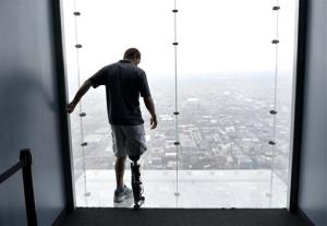 Zac Vawter, fitted with an experimental bionic leg, looks out onto the Ledge at the Willis Tower, Thursday, Oct. 25, 2012, in Chicago.