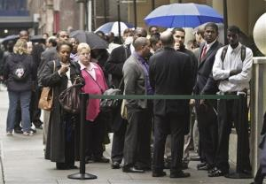 In this Wednesday, Oct. 24, 2012 photo, job seekers wait in line to see employers at the National Career Fairs' job fair in New York.