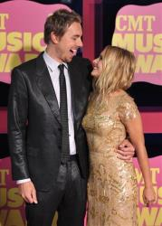 Actor Dax Shepard, left, and actress Kristen Bell arrive at the 2012 CMT Music Awards on Wednesday, June 6, 2012 in Nashville, Tenn.