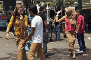 Young Egyptian women are harassed by men on the first day of the Eid al-Fitr holiday in Cairo, Egypt.