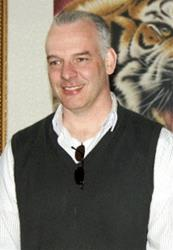 In this April 12, 2011 file photo, Neil Heywood, a British business consultant, smiles at an art gallery in Beijing.