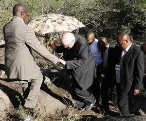 Retired judge Ian Farlam inspects the area where the bodies of mine workers were found, after the shootings at Lonmin's platinum mine in Marikana near Rustenburg, South Africa, Oct. 1, 2012.