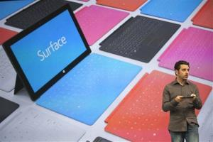Panos Panay, the general manager of the Microsoft Surface holds Surface,  a new tablet computer shown with optional covers options at Hollywood's Milk Studios in Los Angeles.