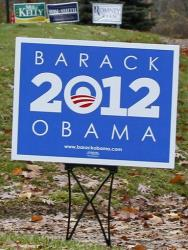 Campaign signs for President Obama and Mitt Romney are seen in yards outside Evans City, Pa., Friday, Nov. 2, 2012.