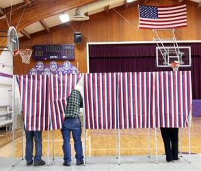 Voters cast their Election Day ballots at Harrison High School in Harrison, Mont., Tuesday, Nov. 6, 2012.