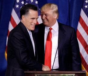 FILE - In this Feb. 2, 2012 file photo, Donald Trump greets Republican presidential candidate, former Massachusetts Gov. Mitt Romney during a news conference in Las Vegas.