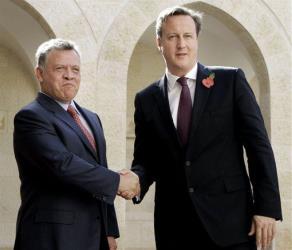 King Abdullah II of Jordan ,left, shake hands with British Prime Minister David Cameron at the Royal Palace in Amman, Jordan, Wednesday, Nov. 7 2012.