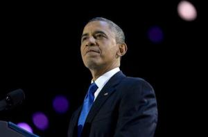 President Obama pauses as he speaks at the election night party at McCormick Place in Chicago.
