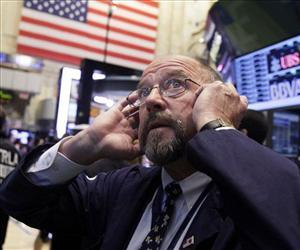 In this Thursday, Sept. 20, 2012 file photo, trader Frederick Reimer works on the floor of the New York Stock Exchange.