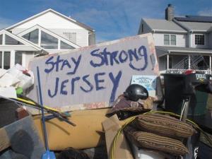 Residents of a flood-wrecked home in Point Pleasant Beach NJ offer encouragement to fellow victims of Superstorm Sandy on Monday, Nov. 5, 2012.